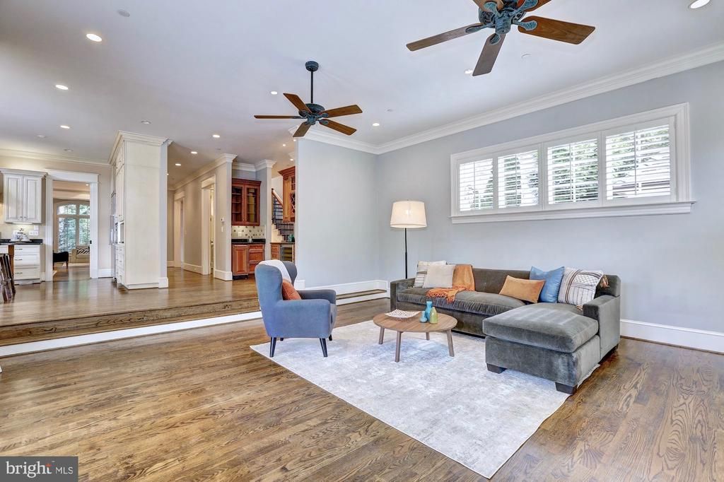 Open-concept family room adjoins kitchen. - 116 E MELROSE ST, CHEVY CHASE