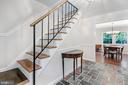 Entrance foyer with wood staircase - 2808 VILLAGE LN, SILVER SPRING