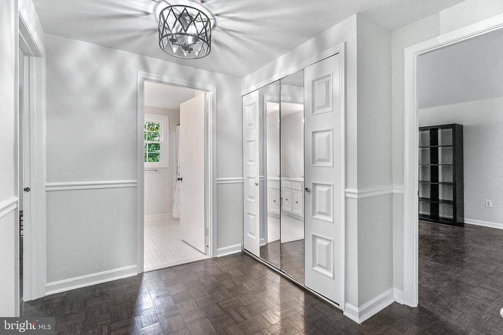 Upper hallway with large linen closet - 2808 VILLAGE LN, SILVER SPRING