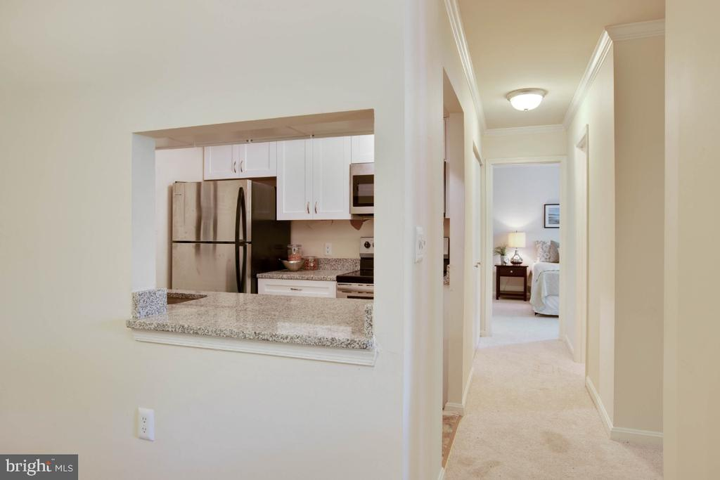 View towards Kitchen and bedrooms - 8203 WHISPERING OAKS WAY #202, GAITHERSBURG