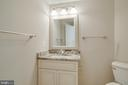 New vanity, mirror, lighting and toilet in powder - 6541 JEROME CT, MANASSAS