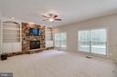 Family room with stone fireplace and built ins - 6541 JEROME CT, MANASSAS