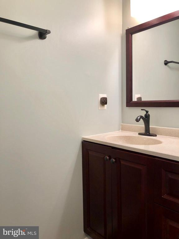 Updated Half Bath - Ceramic tile floor, Main Level - 9505 COUNTRY ROADS LN, MANASSAS