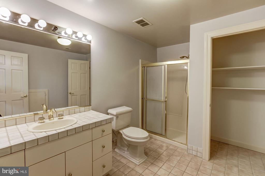 Full bath off rec room - 7115 WOLF DEN RD, FAIRFAX STATION