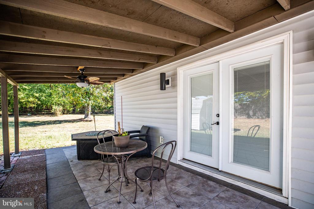 Covered porch & patio outside of studio - 10288 MONCURE DR, RUTHER GLEN