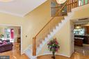 Luxury Curved Staircase in Entry - 8308 ARMETALE LN, FAIRFAX STATION
