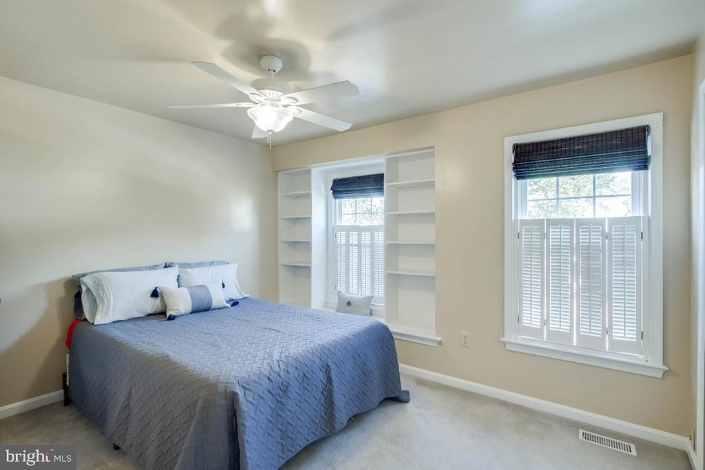Sun filled master bedroom with shelving - 6509 BRICK HEARTH CT, ALEXANDRIA