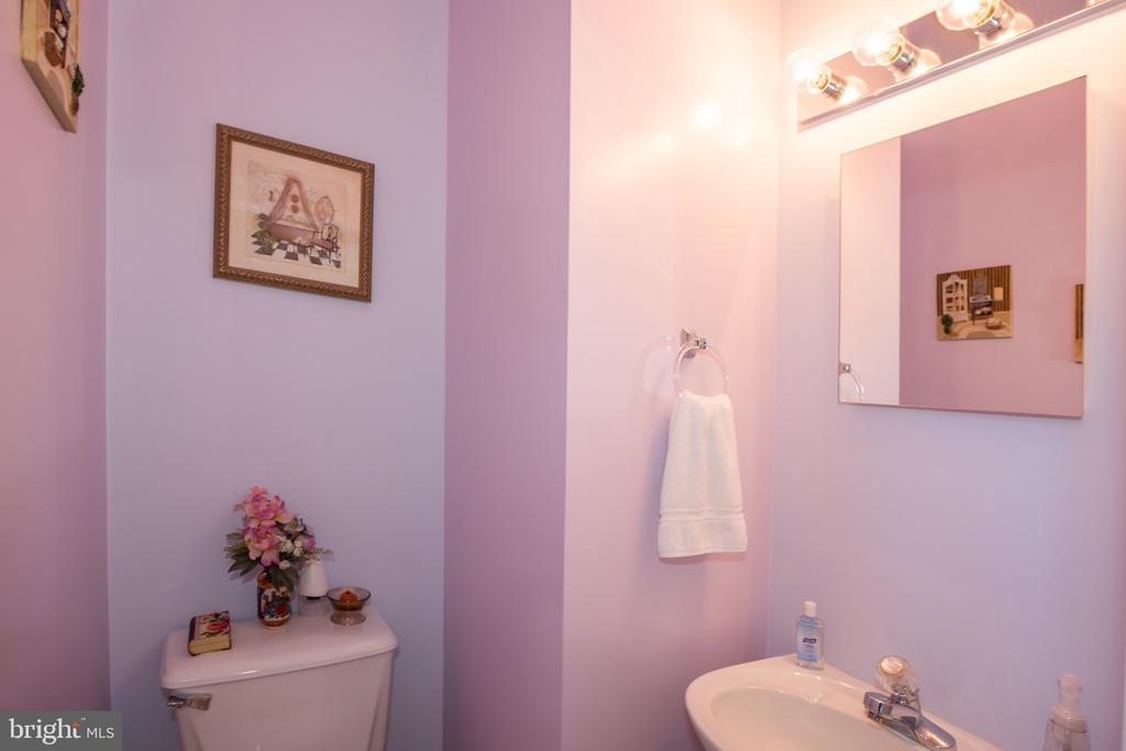 half bath on main level - 9202 MATTHEW DR, MANASSAS PARK