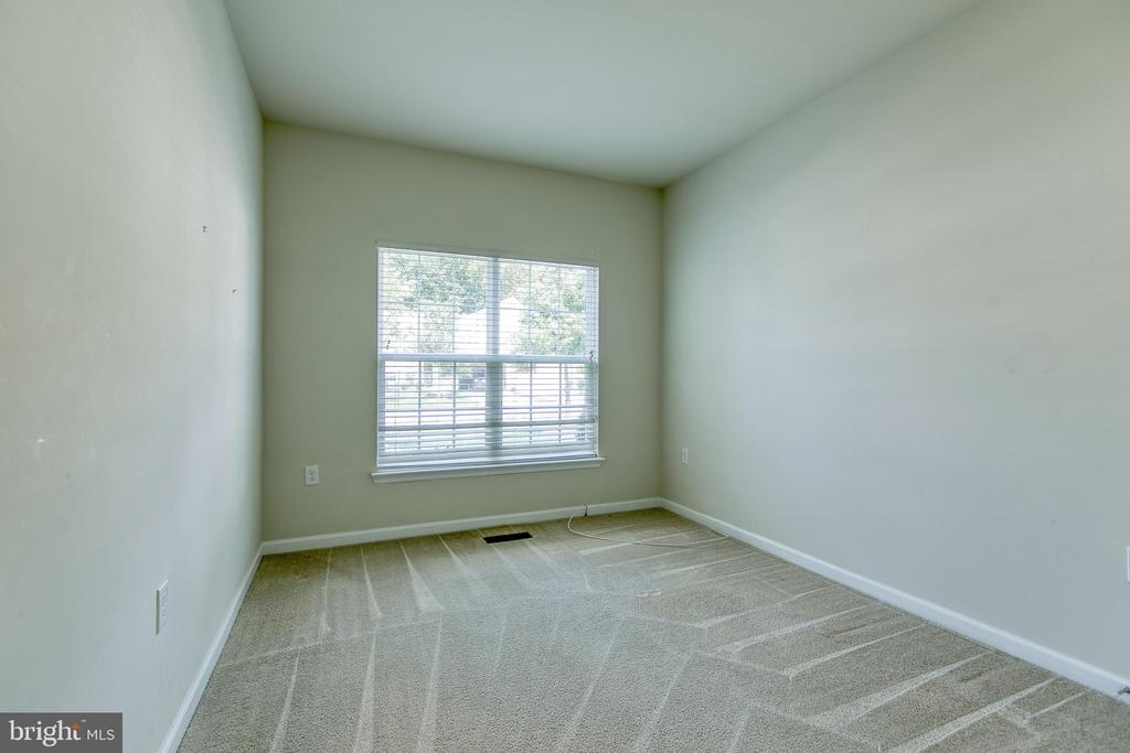 bedroom or office off the foyer.  Large closet. - 220 LONG POINT DR, FREDERICKSBURG