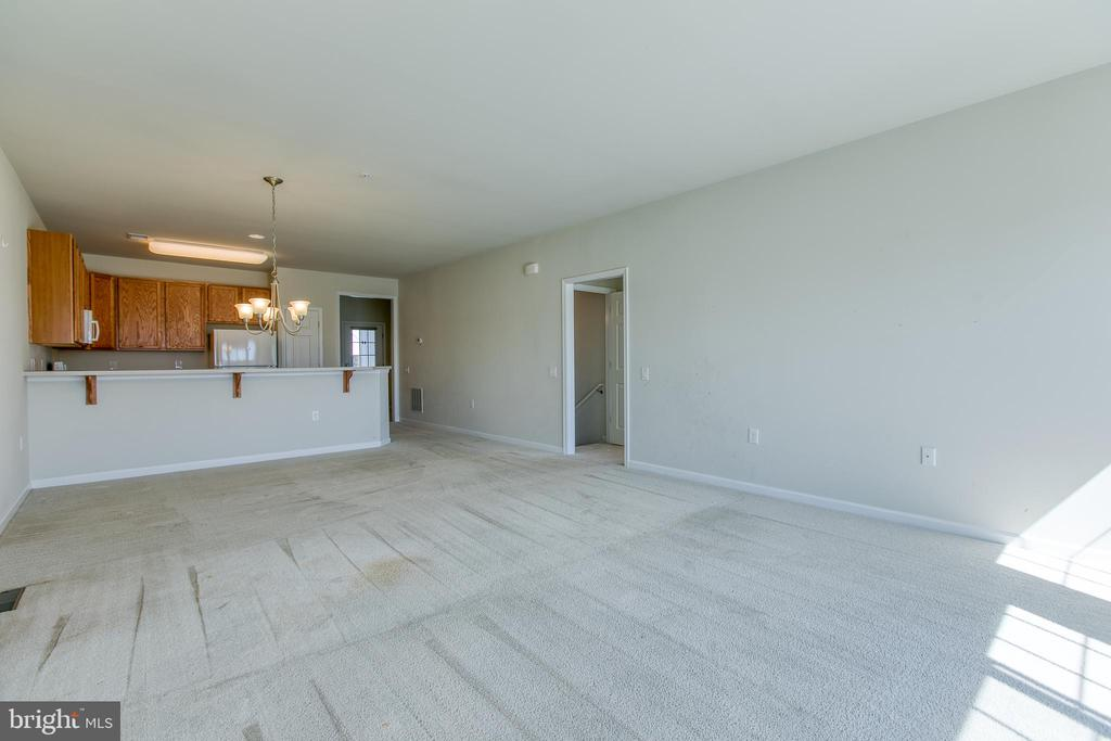 Open floor plan into the living room - 220 LONG POINT DR, FREDERICKSBURG
