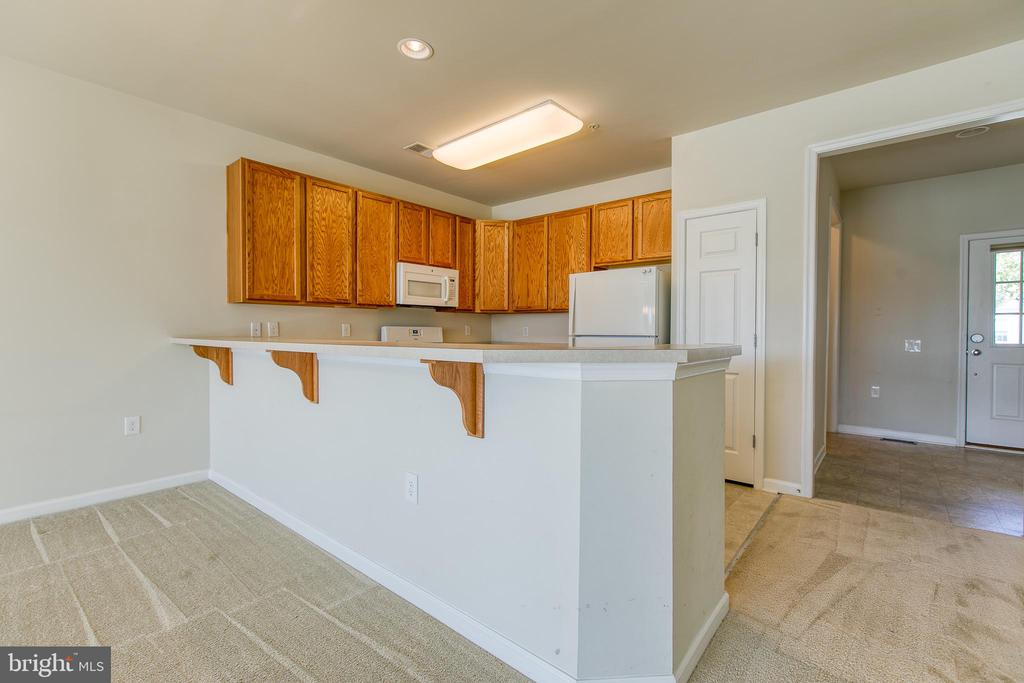 Right off the foyer is the kitchen. - 220 LONG POINT DR, FREDERICKSBURG