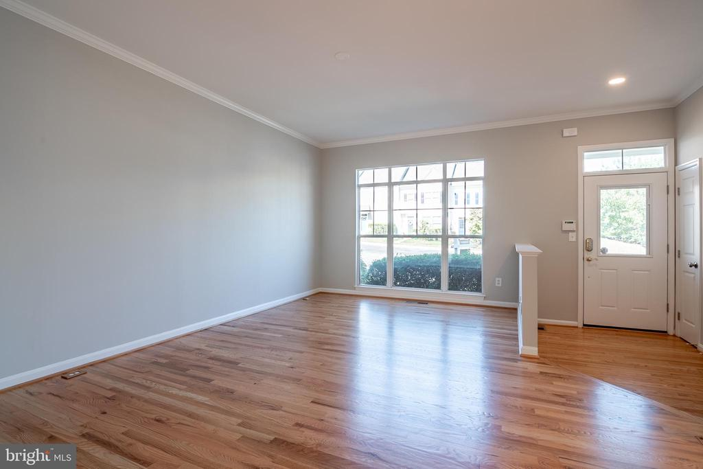 Large windows and hardwood floors in living room - 3968 HARTLAKE ST, WOODBRIDGE