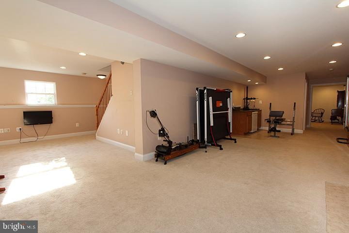 Lower level recreation room- Alt view - 806 SANTMYER DR SE, LEESBURG