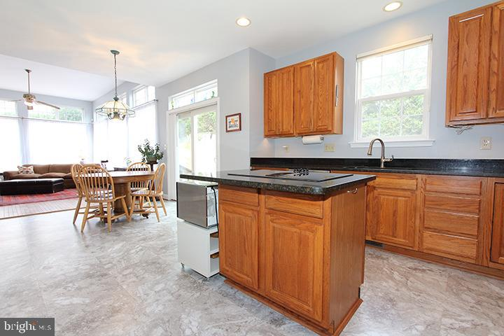 Large eat in kitchen with brand new flooring! - 806 SANTMYER DR SE, LEESBURG
