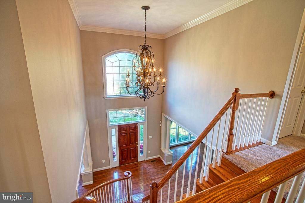 Fabulous Chandelier in the Entry of the Home - 42763 FOREST CREST CT, ASHBURN