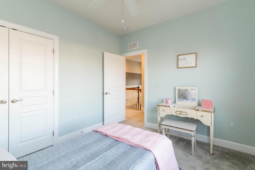 Bedroom 4 closet has custom built-ins - 15475 BERKHAMSTEAD PL, LEESBURG