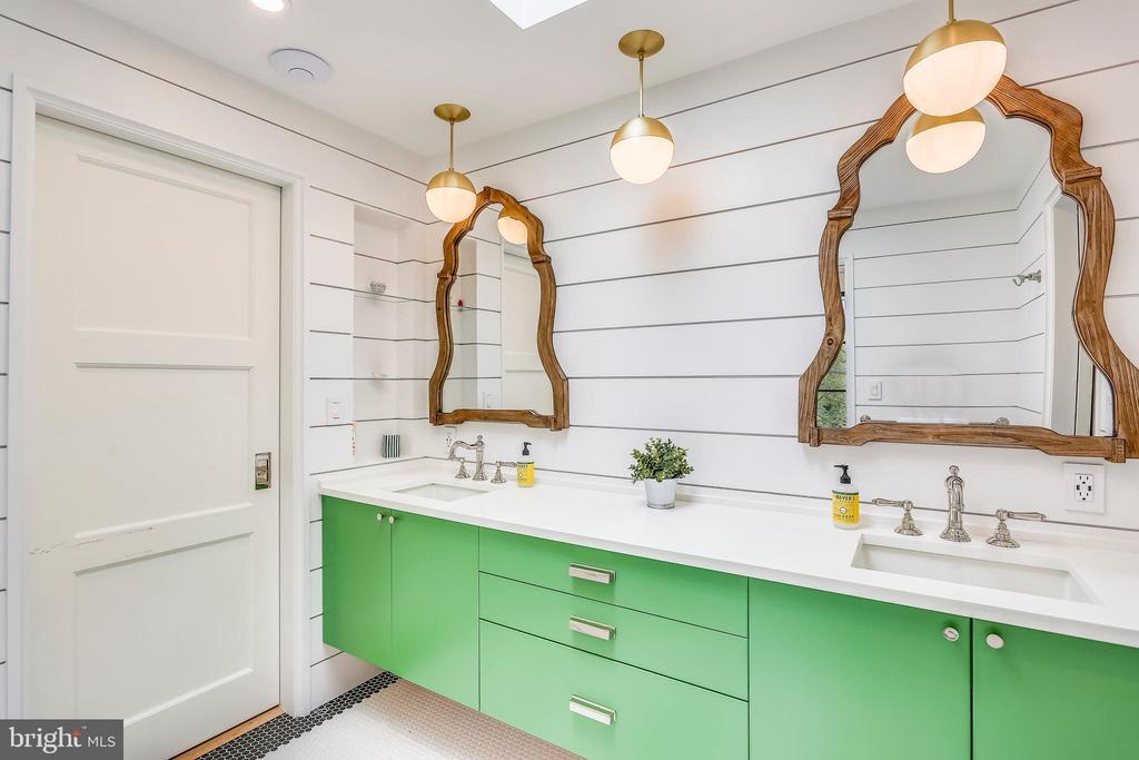 loft bathroom with skylight and shiplap - 6404 GARNETT DR, CHEVY CHASE