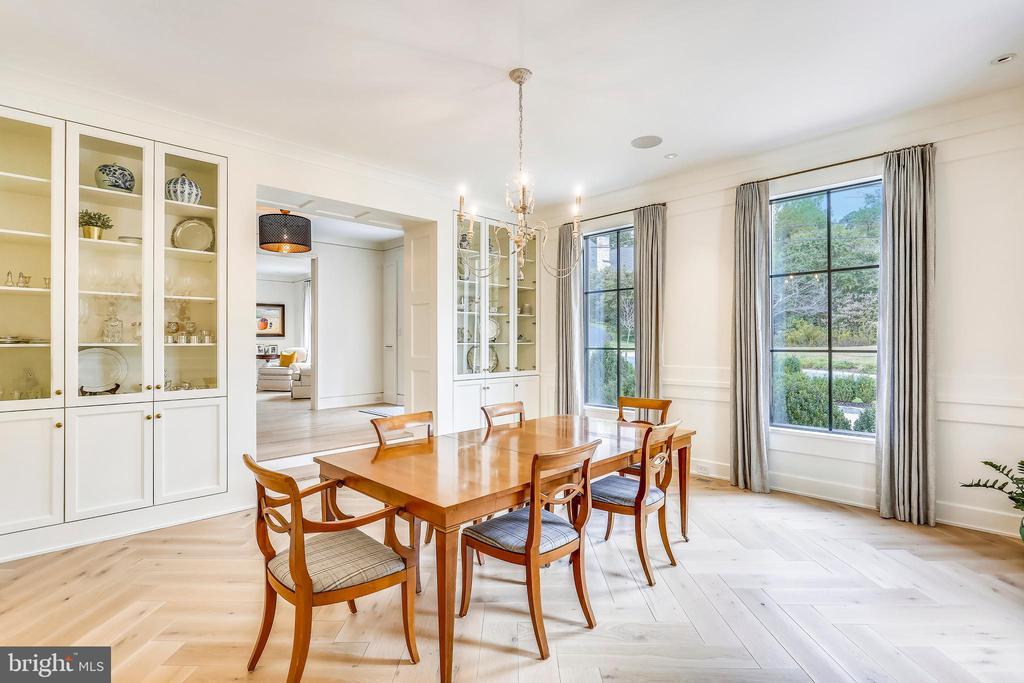 sunken dining room with herringbone laid white oak - 6404 GARNETT DR, CHEVY CHASE