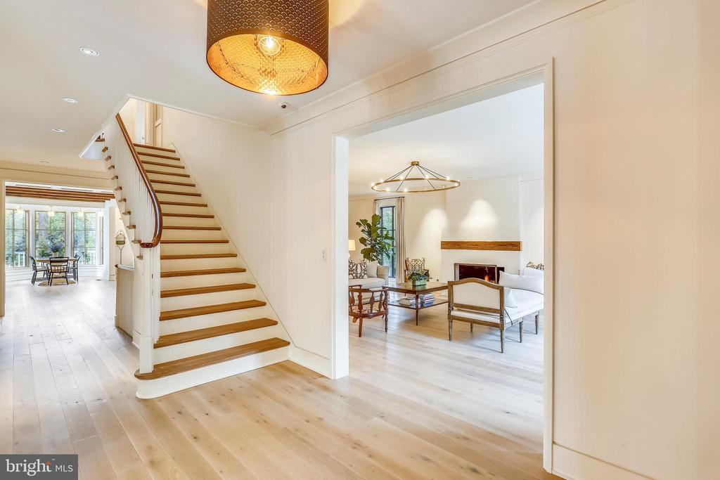 elegant continuous railing. white oak floors - 6404 GARNETT DR, CHEVY CHASE
