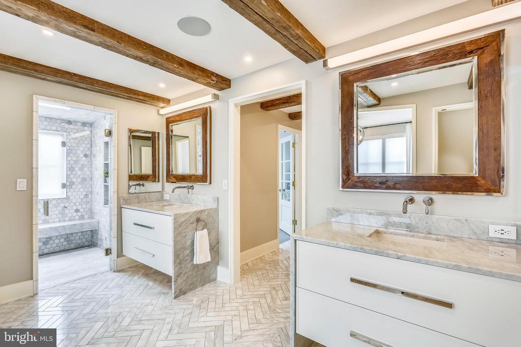 under-lit floating vanities. heated marble floor - 6404 GARNETT DR, CHEVY CHASE