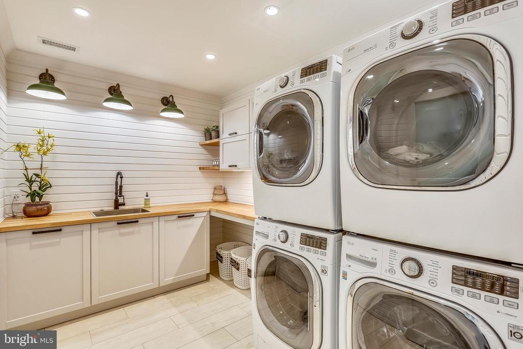 bedroom level double laundry. hide-a-hose vacuum - 6404 GARNETT DR, CHEVY CHASE