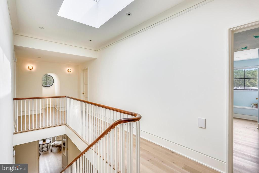 loft level hall with large skylight - 6404 GARNETT DR, CHEVY CHASE