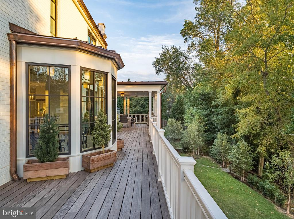 ipe decking connects two covered terraces - 6404 GARNETT DR, CHEVY CHASE