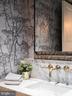 floating vanity & wall mount loo in powder room - 6404 GARNETT DR, CHEVY CHASE