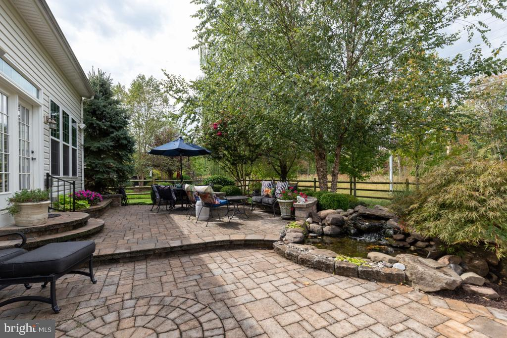 Enjoy BBQs and peace by the water feature. - 25401 JUBILANT DR, ALDIE