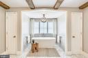 linen & luggage closets flank soaking tub - 6404 GARNETT DR, CHEVY CHASE