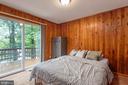 BEDROOM 1~MAIN LEVEL W/SLIDERS TO REAR DECK - 7313 OAKWOOD DR, ORANGE