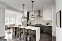 Breakfast bar seating and pendant lighting - 1362 OAK ST NW, WASHINGTON