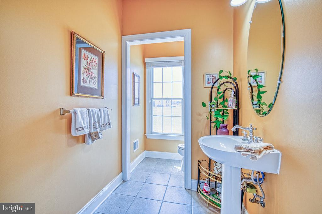 Main level half bath - 15500 BANKFIELD DR, WATERFORD