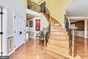 Foyer w/coat closet, art niche & curved stairs - 20190 KIAWAH ISLAND DR, ASHBURN