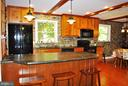 The renovated kitchen features soapstone counters - 21 ANNIES LN, SPERRYVILLE