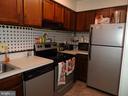 Kitchen with newer appliances - 9746 HAGEL CIR #E, LORTON
