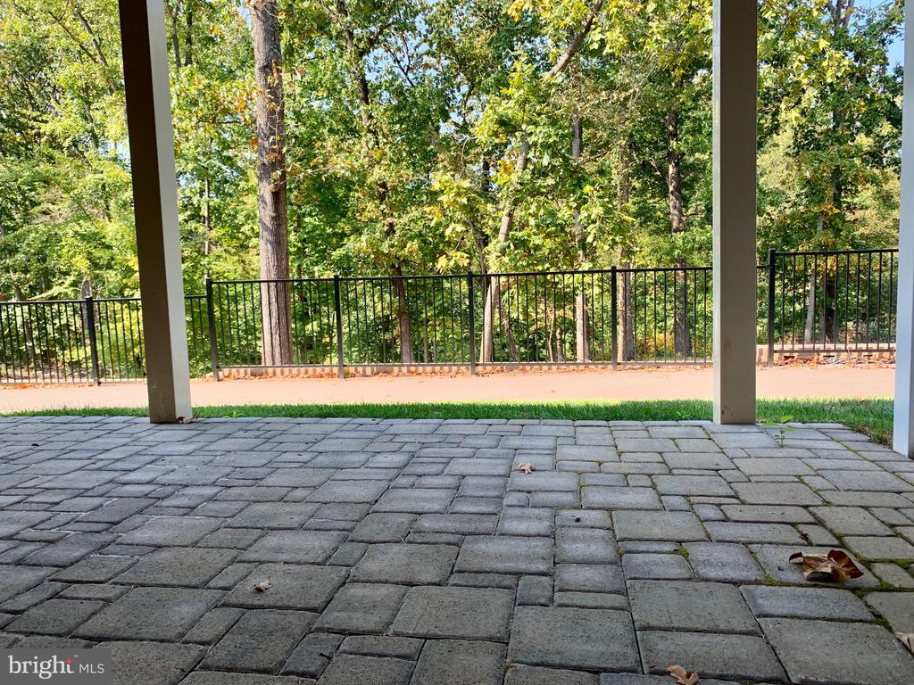 Lower Level Patio. 1/3 outdoor spaces. Actual Home - 4904 TRAIL VISTA LN, CHANTILLY