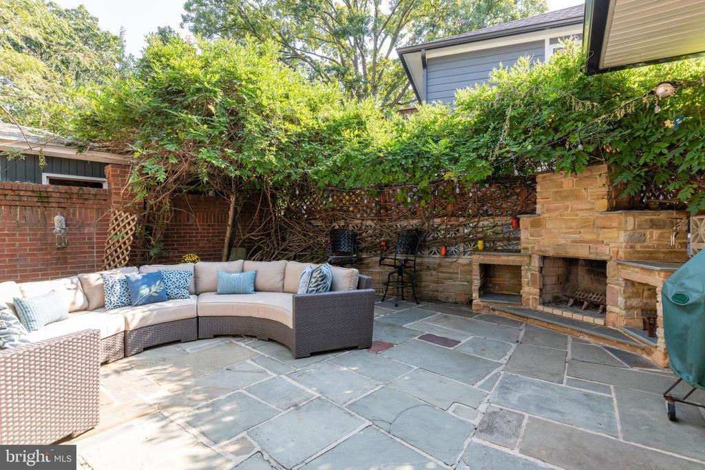 Private patio with stone fireplace - 830 W BRADDOCK RD, ALEXANDRIA