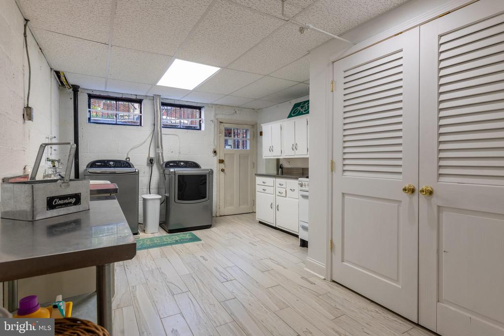 Laundry room with access to the patio - 830 W BRADDOCK RD, ALEXANDRIA