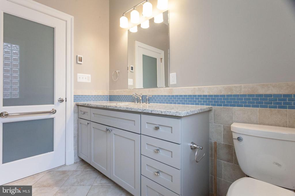 Master bath with W/D and secondary water heater - 3700 ALBEMARLE ST NW, WASHINGTON