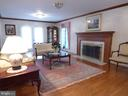 Large living room with fireplace adding warmth ... - 12219 CHAPEL RD, CLIFTON