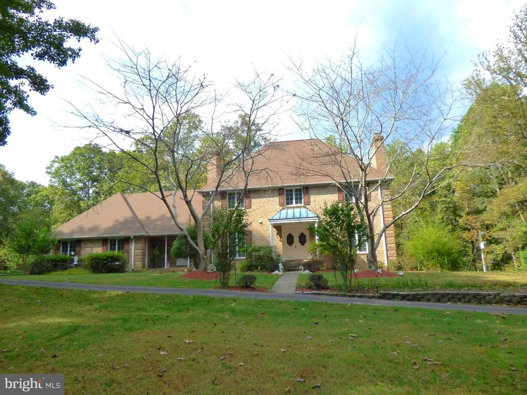 All brick colonial on 5 acres of land. - 12219 CHAPEL RD, CLIFTON
