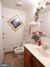 Powder room on main level for guests. - 12219 CHAPEL RD, CLIFTON