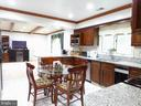 Large kitchen with eat-in table . - 12219 CHAPEL RD, CLIFTON