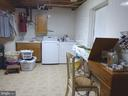 Large laundry room with an extra door to the back - 12219 CHAPEL RD, CLIFTON
