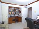 Office on main level with built-in book case - 12219 CHAPEL RD, CLIFTON