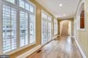 Main level hall opens to private patio. - 9880 PALACE GREEN WAY, VIENNA