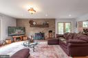 Living Room Features a Brick Fireplace - 4820 WINTERGREEN CT, WOODBRIDGE