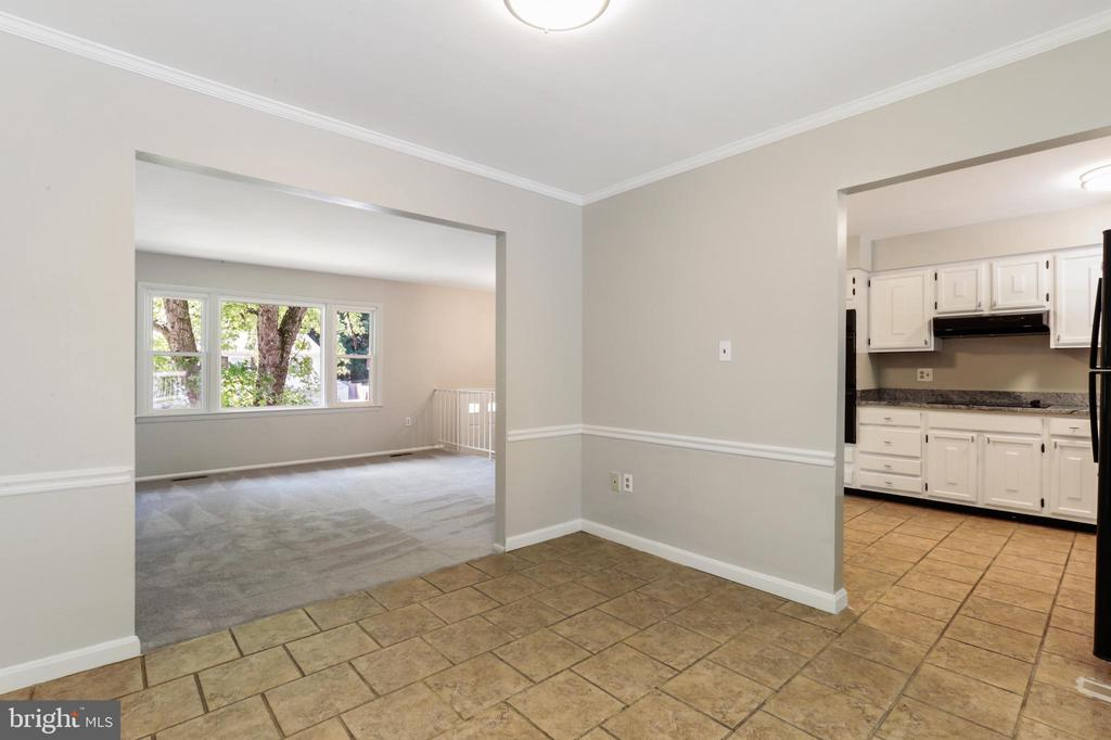 VIEW OF DINING ROOM TO KITCHEN AND LIVING ROOM - 13227 NASSAU DR, WOODBRIDGE