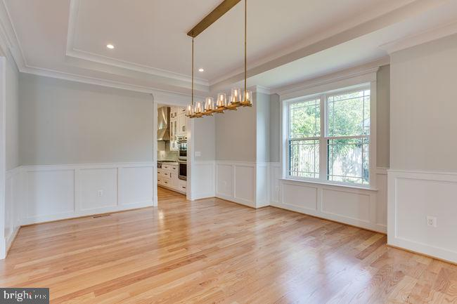 Dinning room with modern light fixtures. - 7022 HECTOR RD, MCLEAN
